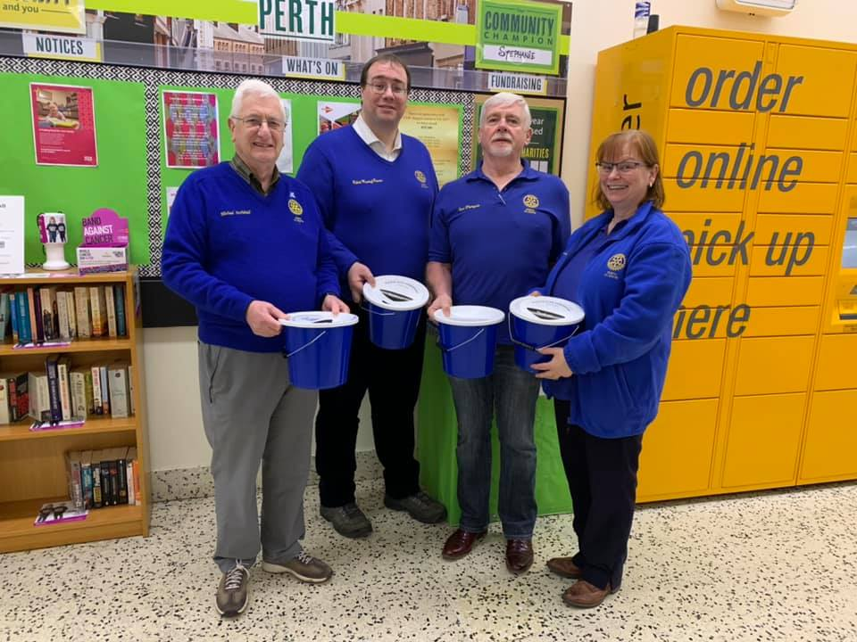 Rotarians with collection buckets in a supermarket